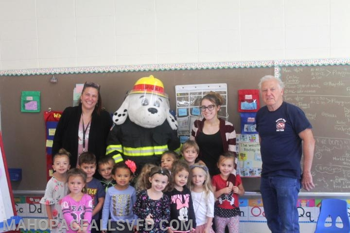 SPARKY and Firefighter Walt stop to get a group shot with their new friends