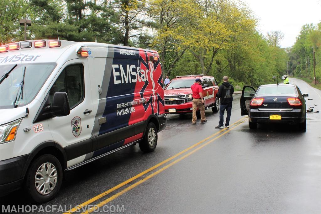 EMStar paramedics begin triage of the car's occupants