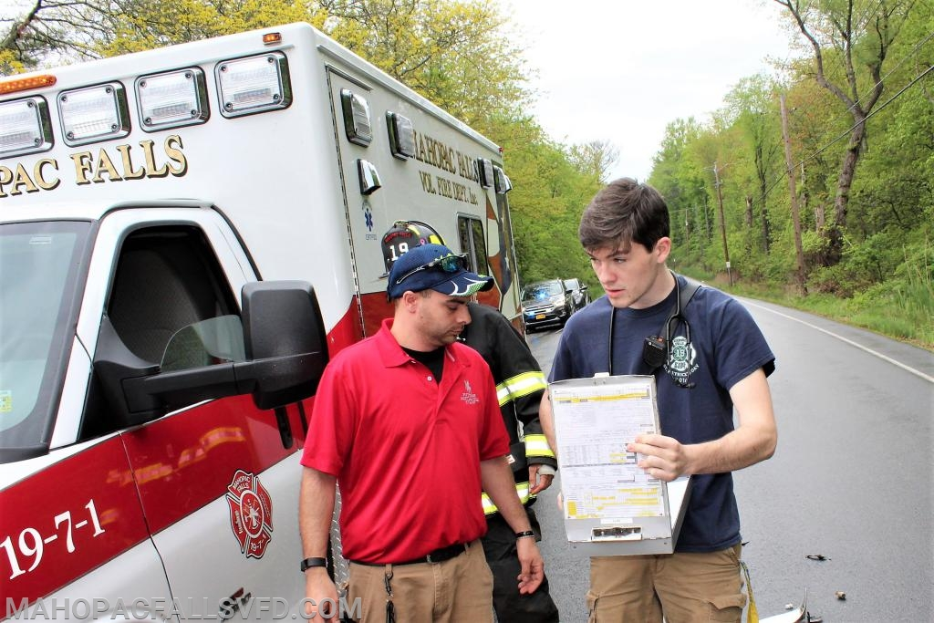 Fire fighter Jason Stasiak(l) double checks the list of students heading for the nurse's office with  EMT P.J. Kelly (R)